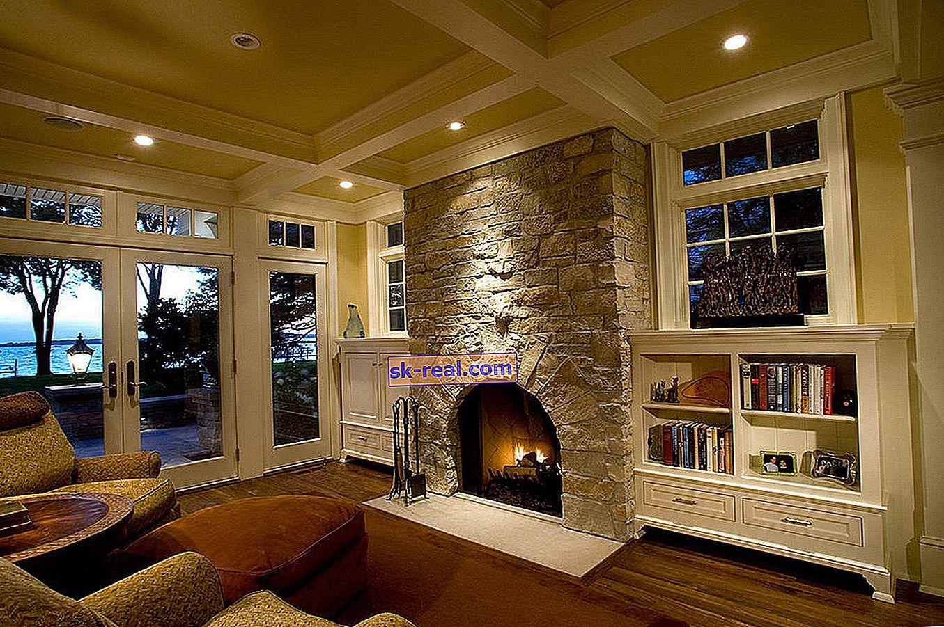 Dizajn dnevnog boravka s kaminom u privatnoj kući